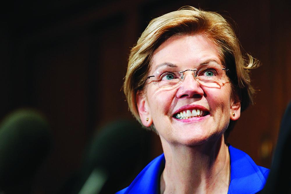 Sen. Elizabeth Warren, D-Mass., listens to Rep. Jim Clyburn, D-S.C., at an event about their bi ...