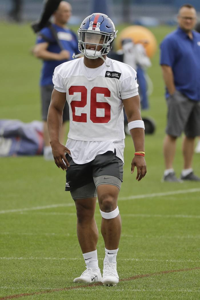 New York Giants' Saquon Barkley (26) warms up at the team's NFL football training facility Wedn ...