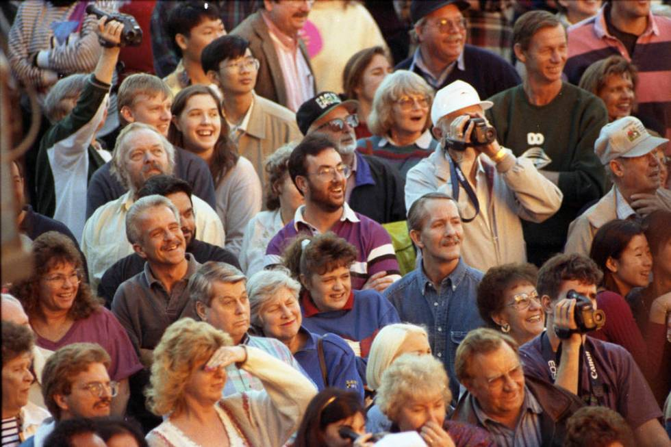 Spectators gathered along Las Vegas Boulevard to record the free show on their high-tech camcor ...