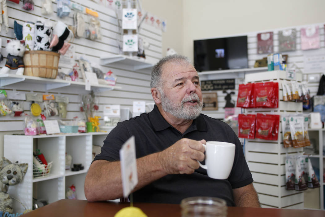 Volunteer Carl Fruge sips a cup of tea at the Rescued Treasures Cat Cafe, Tuesday, Aug. 6, 2019 ...