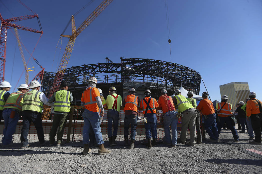 Workers attend the Las Vegas Stadium Topping Out Ceremony in Las Vegas, Monday, Aug. 5, 2019. ( ...