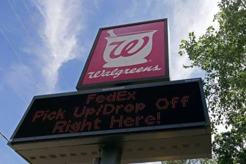 Signage is shown at a Walgreens location in Mebane, N.C., Tuesday, June 25, 2019. (AP Photo/Ger ...