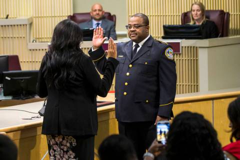 Henderson police chief Thedrick Andres stands during his ceremonial oath of office with Henders ...