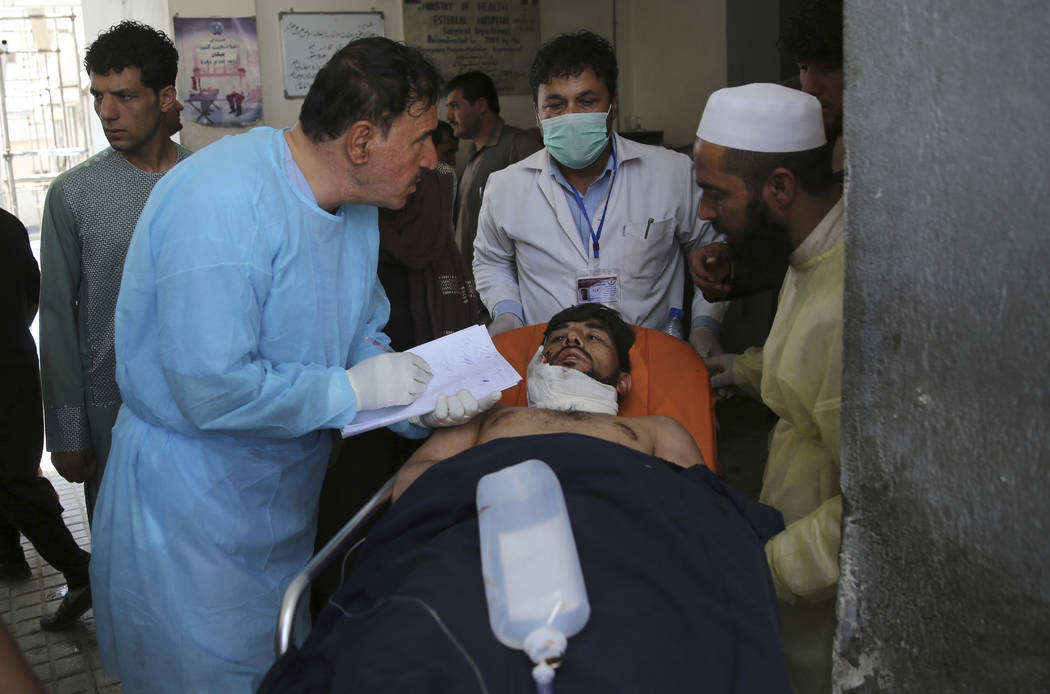 A wounded man receives treatment at a hospital after an explosion in Kabul, Afghanistan, Wednes ...