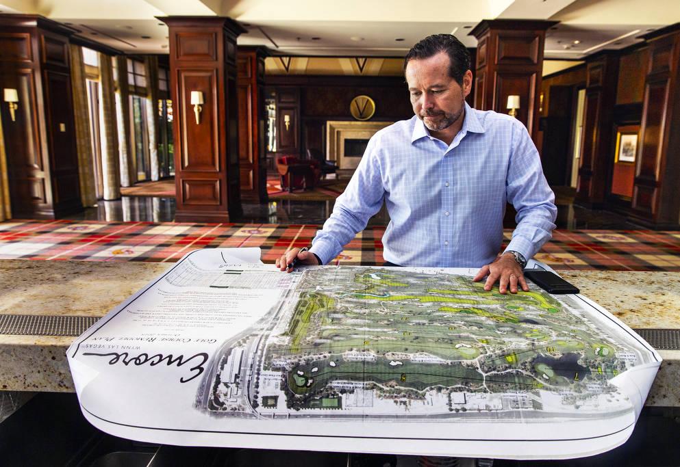Wynn Las Vegas Executive Director of Golf Operations Brian Hawthorne views a map of Wynn Golf C ...