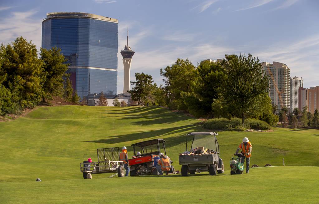 A maintenance crew manicures a green at Wynn Golf Club on Tuesday, July 30, 2019, in Las Vegas. ...