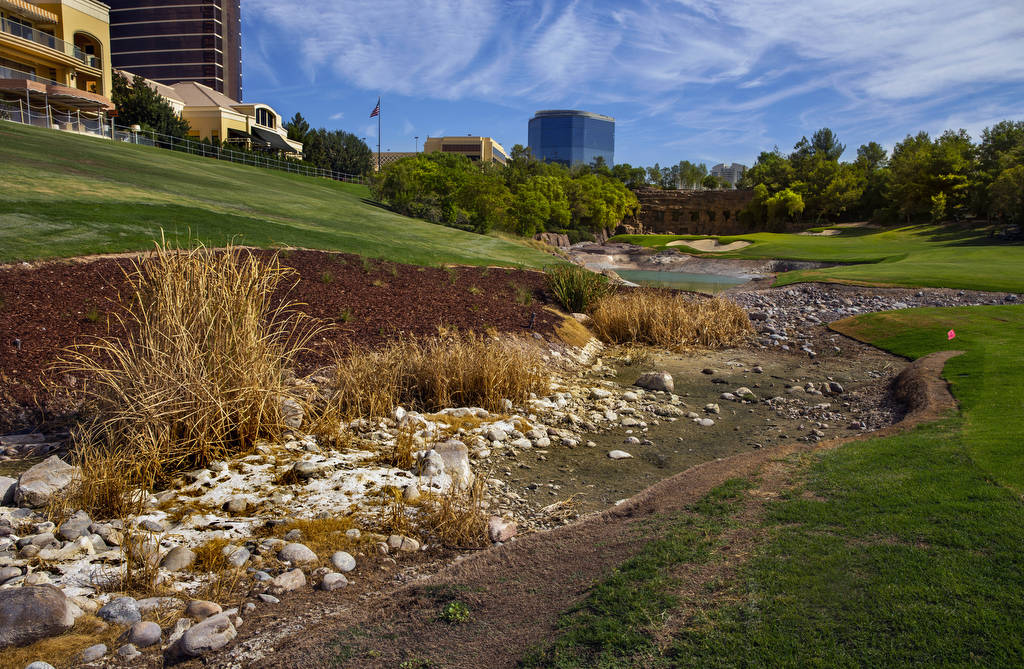 A stream and waterfall feature are shown under construction at Wynn Golf Club on Tuesday, July ...