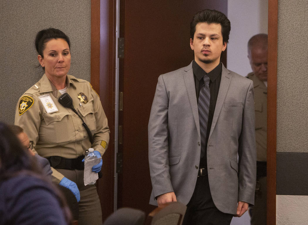 Jaiden Caruso walks back for the verdict in his murder trial at the Regional Justice Center on ...