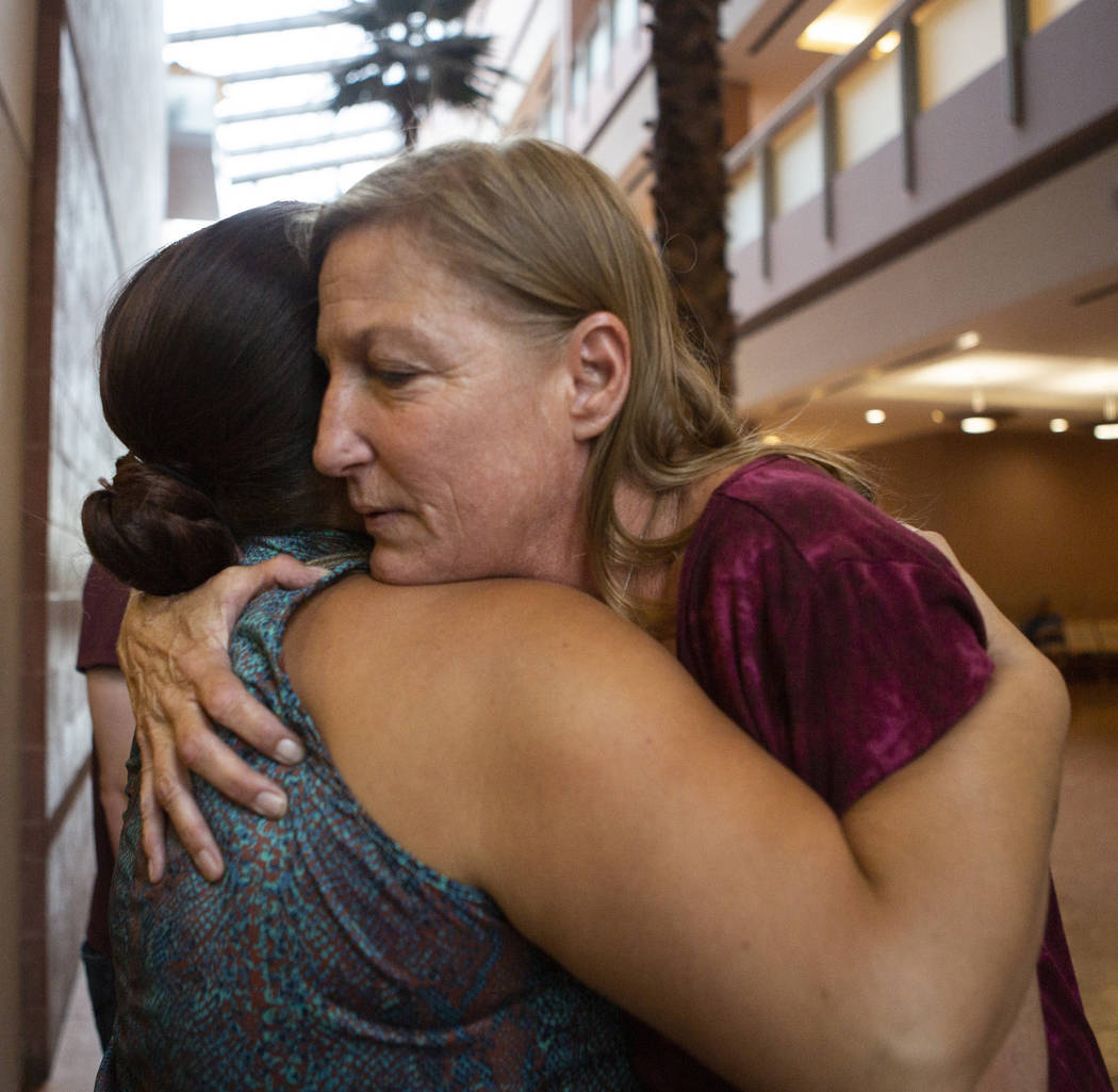 Jamie Minkler, right, hugs Misty Manuel at the Regional Justice Center on Wednesday, Aug. 7, 20 ...