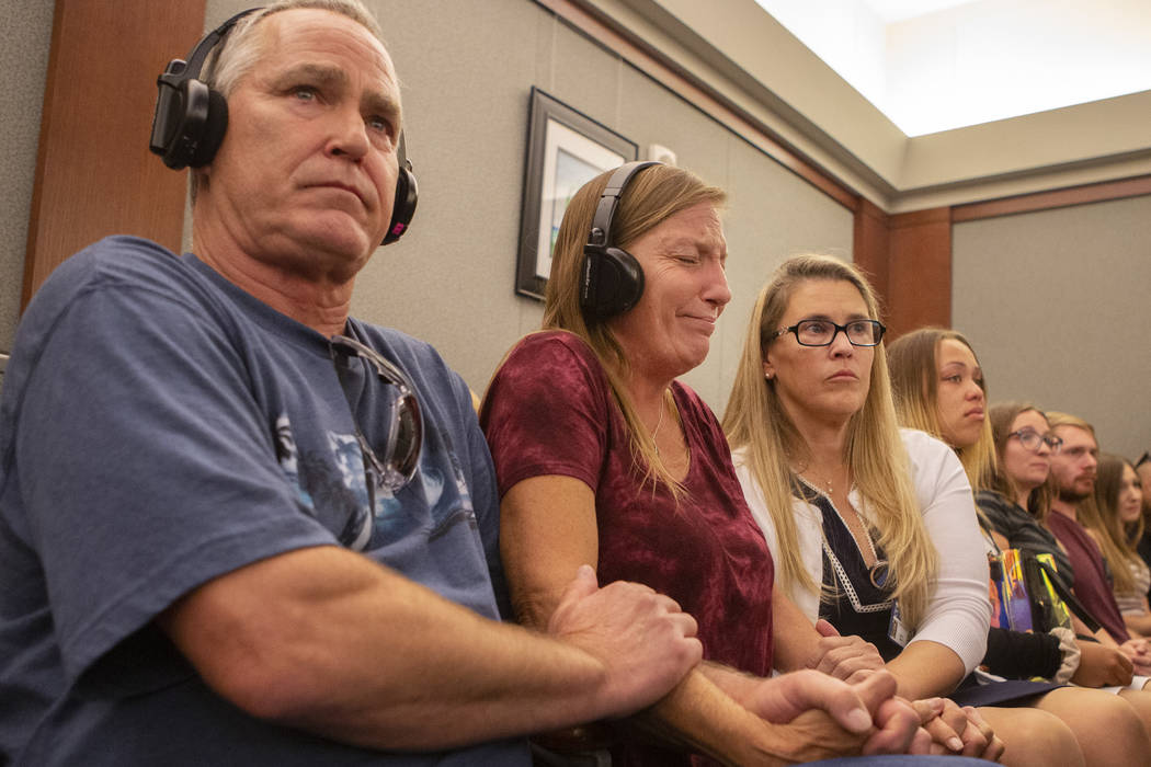 Parents Steve and Jamie Minkler are comforted by victim advocate Sara Owen while listening to t ...
