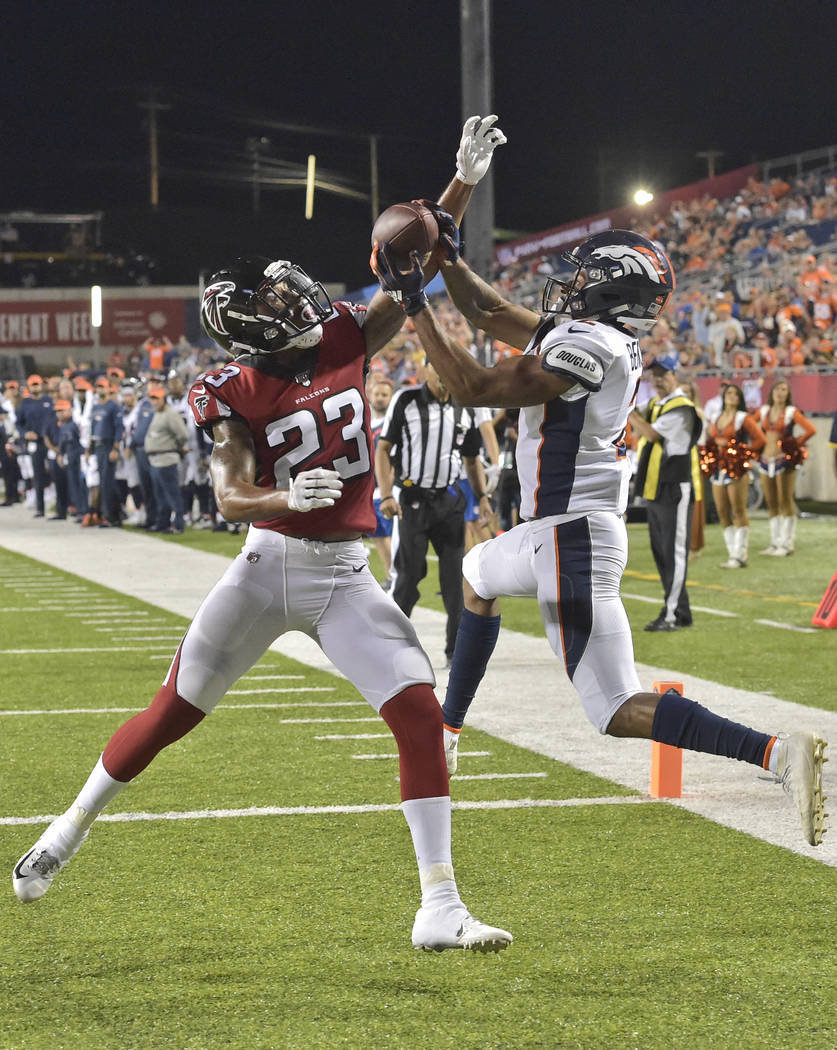 Denver Broncos wide receiver Trinity Benson (2) can't catch a pass under pressure from Atlanta ...