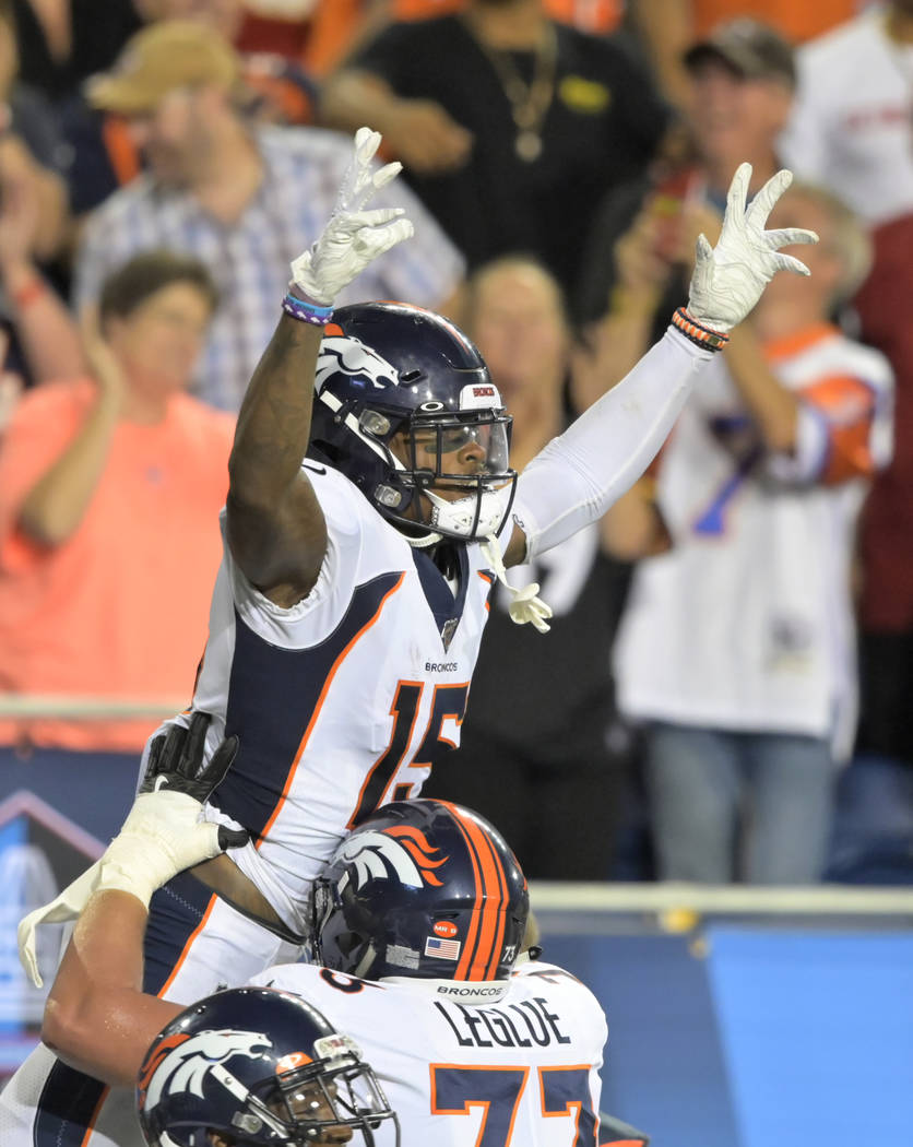 Denver Broncos wide receiver Juwann Winfree celebrates after catching a touchdown pass during t ...
