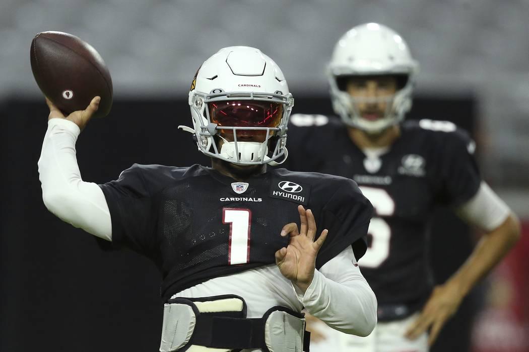 Arizona Cardinals quarterback Kyler Murray throws the ball during an NFL football training camp ...