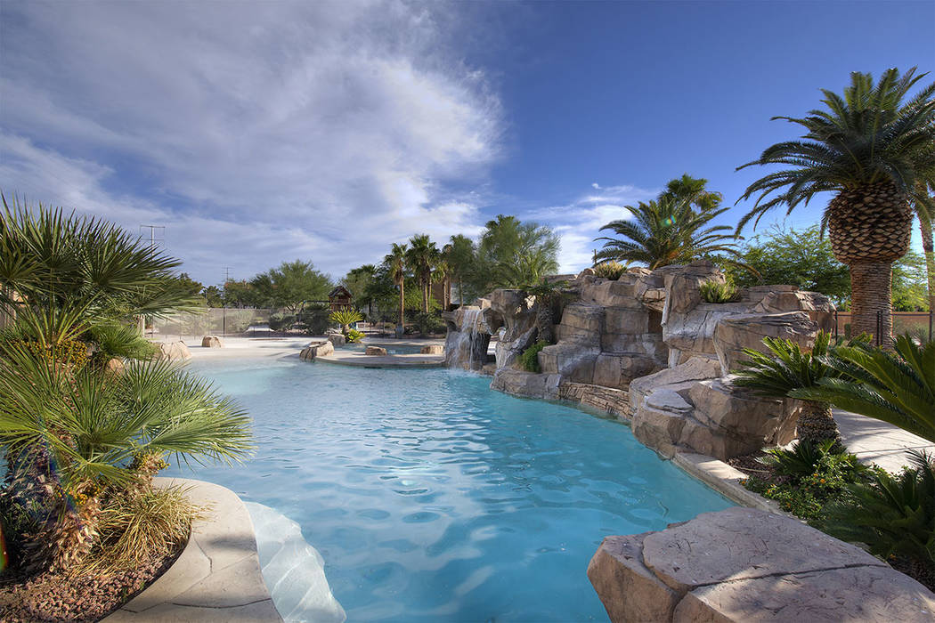 The pool has waterfalls. (Synergy Sotheby's International Realty)