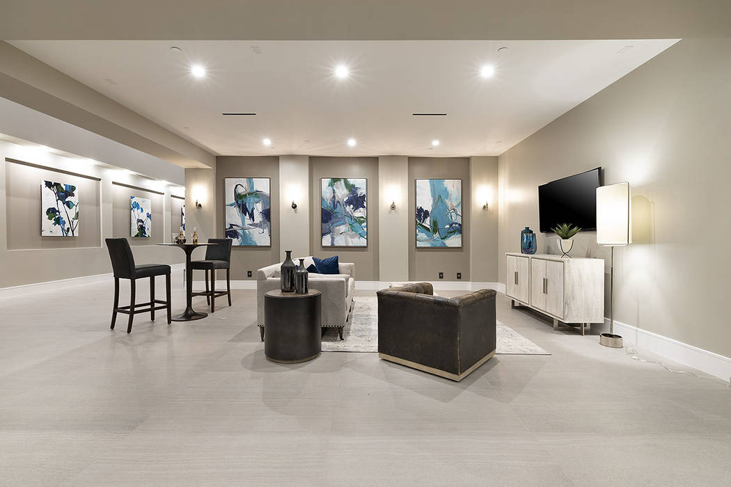 The media room has an upscale look. (Synergy Sotheby's International Realty)