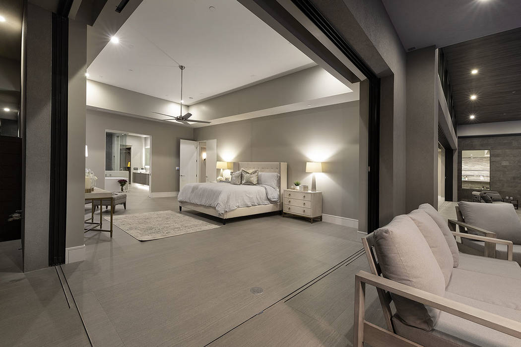 The master bedroom's corner wall opens to a balcony. (Synergy Sotheby's International Realty)