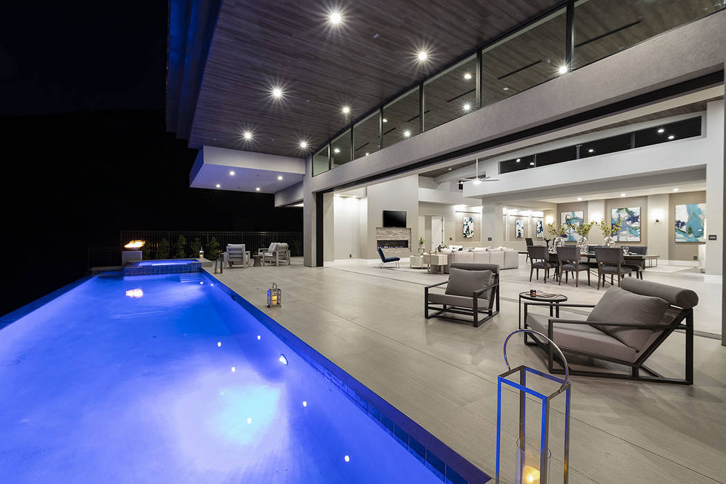 The pool runs along the back patio. (Synergy Sotheby's International Realty)