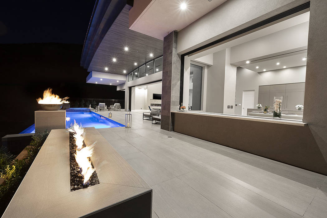 Fire features are showcased in the pool area. (Synergy Sotheby's International Realty)