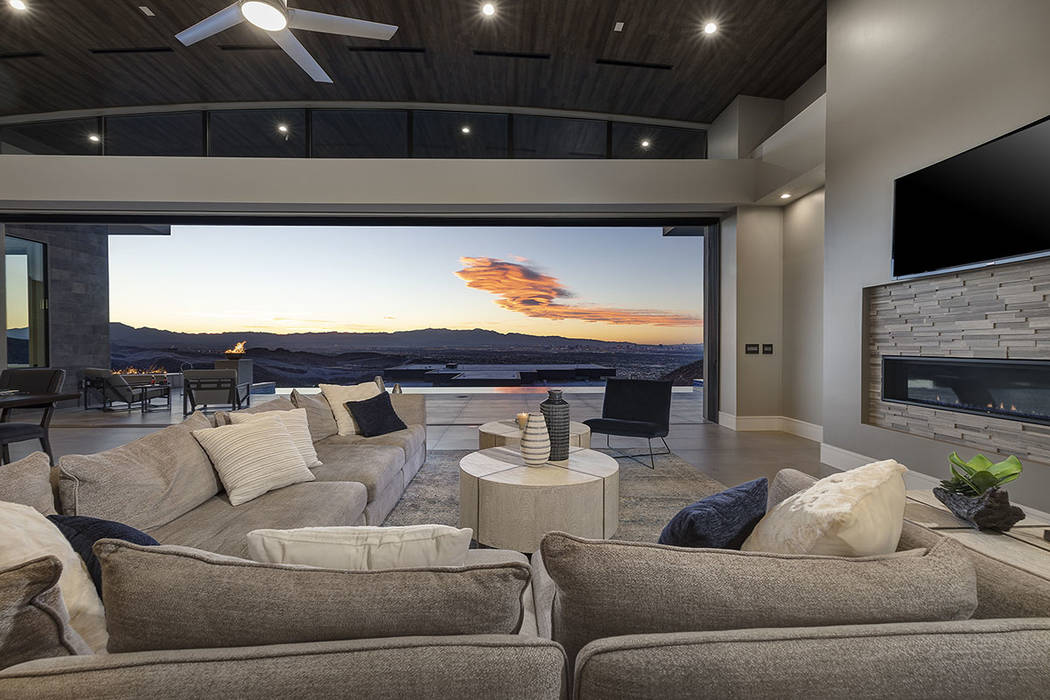 The great room features a modern fireplace. (Synergy Sotheby's International Realty)