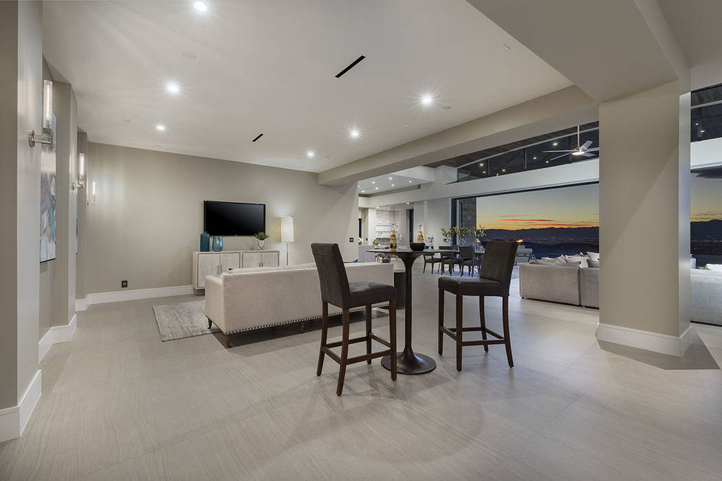 There is lots of seating to take in a movie or game. (Synergy Sotheby's International Realty