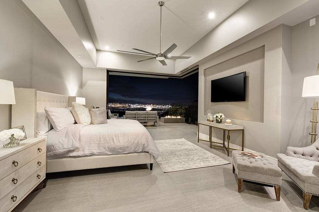 The master bedroom opens to a balcony with a fire feature and views of the Las Vegas Strip. (Sy ...