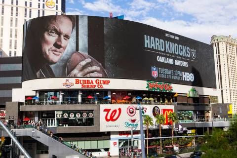 A digital billboard displays Oakland Raiders coach Jon Gruden in an advertisement for the upcom ...