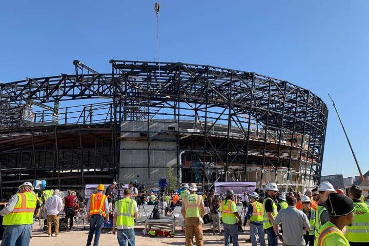 Dignitaries and construction workers take part in a topping out ceremony at Las Vegas Stadium, ...