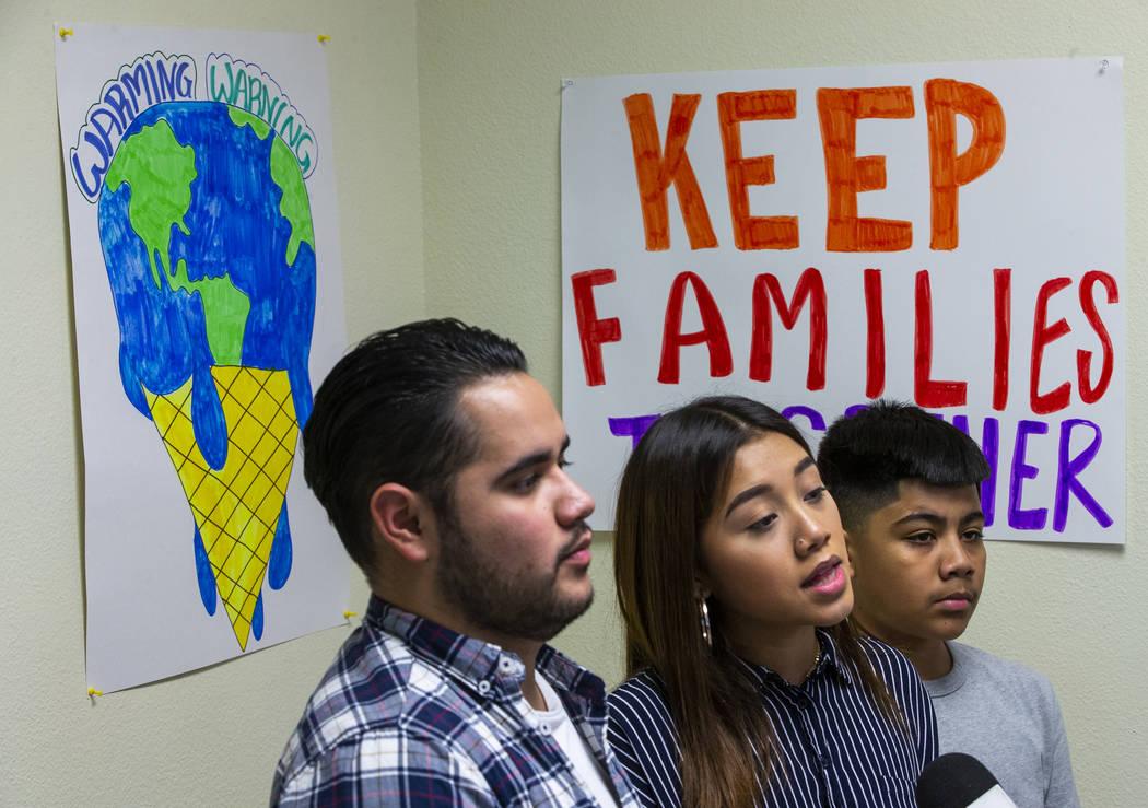 Omar Arellano Cruz, 21, left, Kimberly Arellano Cruz, 16, and AJ Arellano Cruz,12, respond to a ...