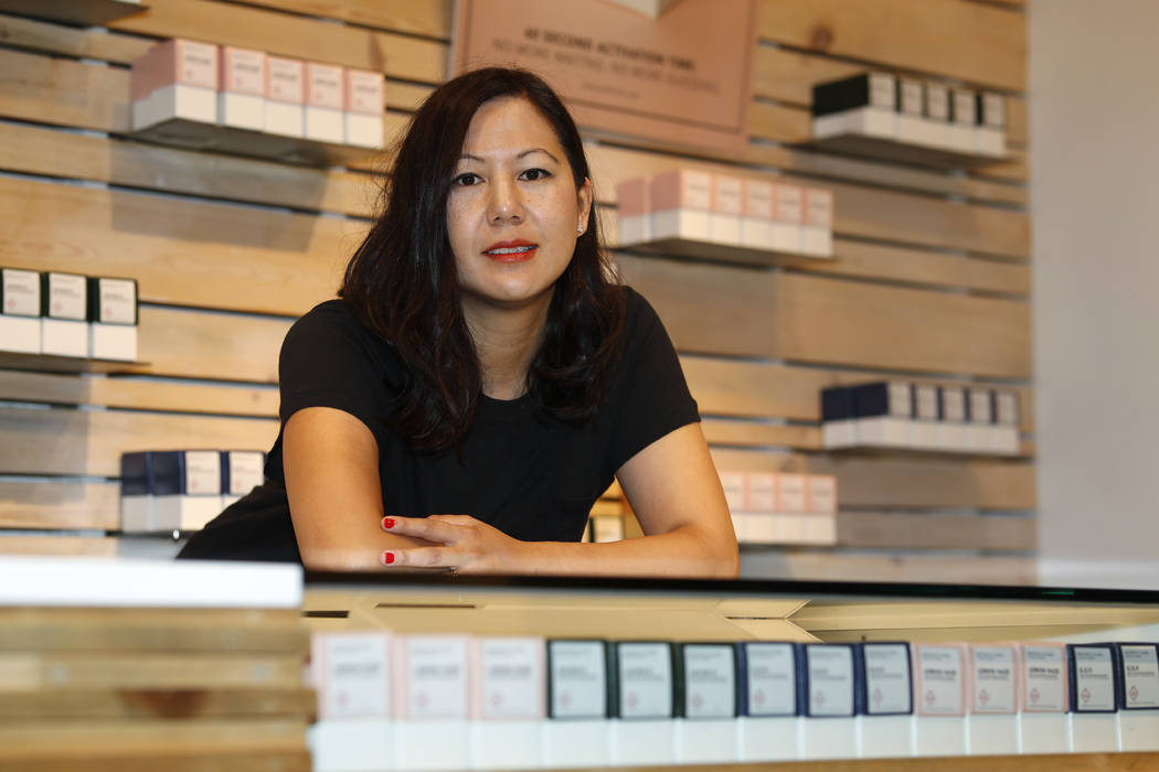 In this Friday, July 26, 2019 photo, Leslie Siu poses for a portrait next to her cannabis produ ...