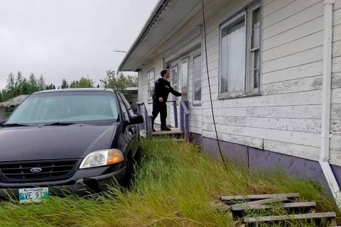 In this recent photo provided by the Royal Canadian Mounted Police, RCMP officers canvas homes ...
