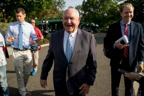 FILE--Agriculture Secretary Sonny Perdue laughs with a reporter on the North Lawn of the White ...