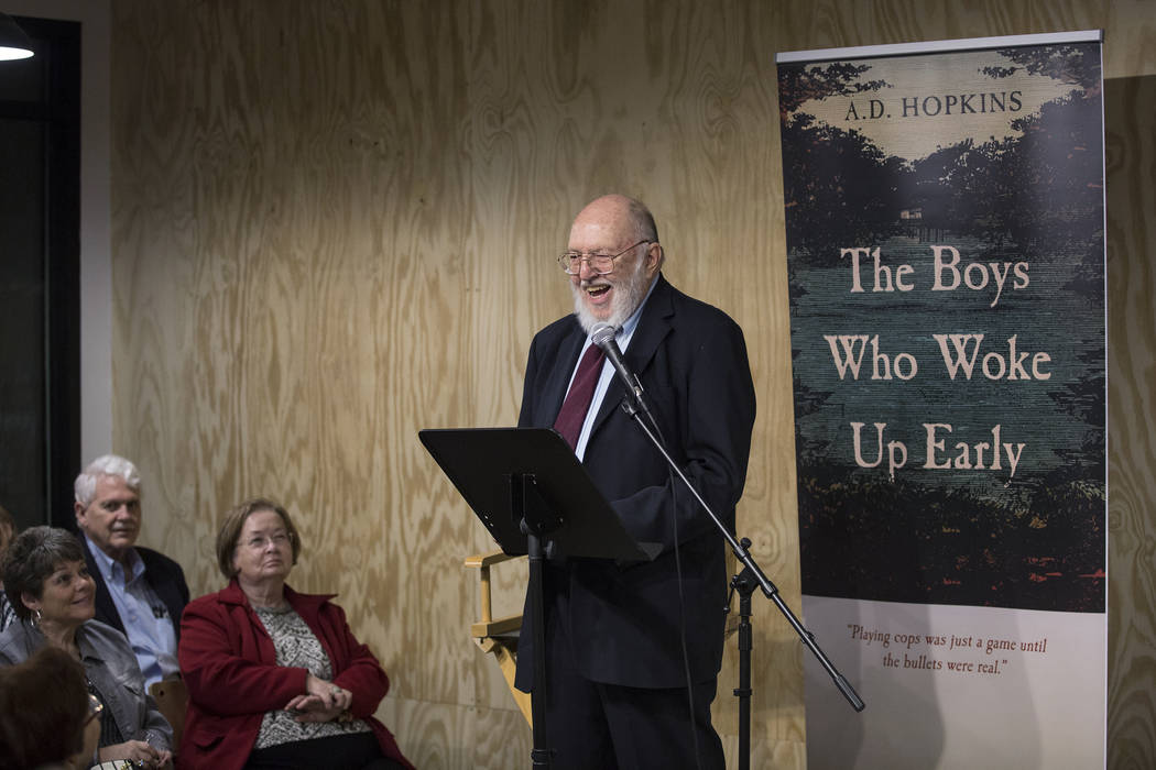 "Author A.D. Hopkins reads from his novel, ""The Boys Who Woke Up Early,"" during a book release p ..."