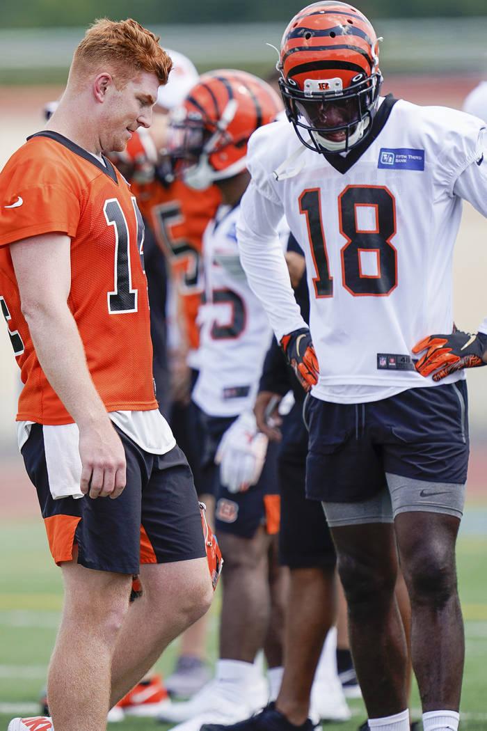 Cincinnati Bengals quarterback Andy Dalton (14) talks with wide receiver A.J. Green (18) during ...
