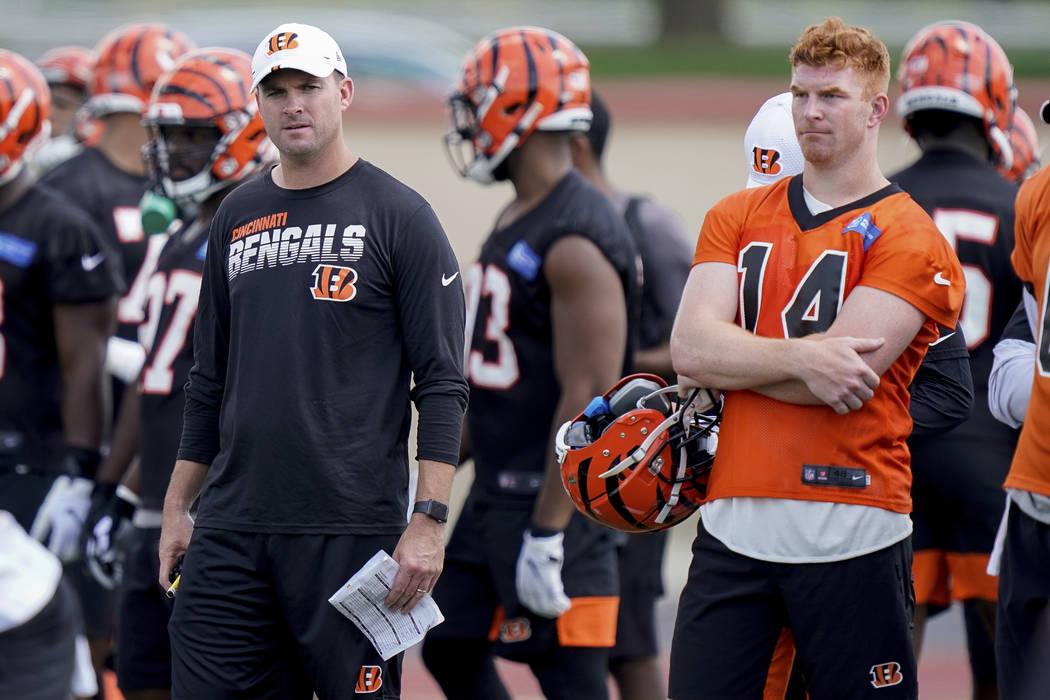 Cincinnati Bengals head coach Zac Taylor and quarterback Andy Dalton (14) watch practice during ...