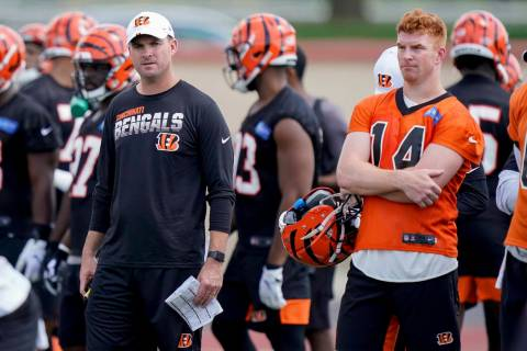 Cincinnati Bengals head coach Zac Taylor and quarterback Andy Dalton (14) watch practice during ...