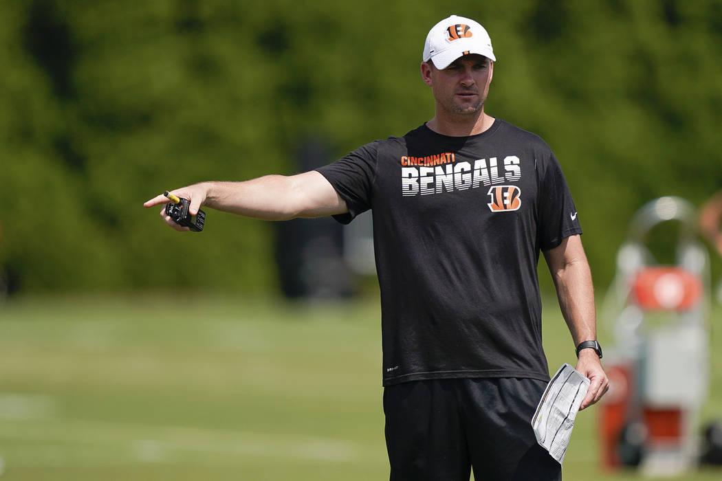 Cincinnati Bengals head coach Zac Taylor directs players during NFL football training camp, Sun ...