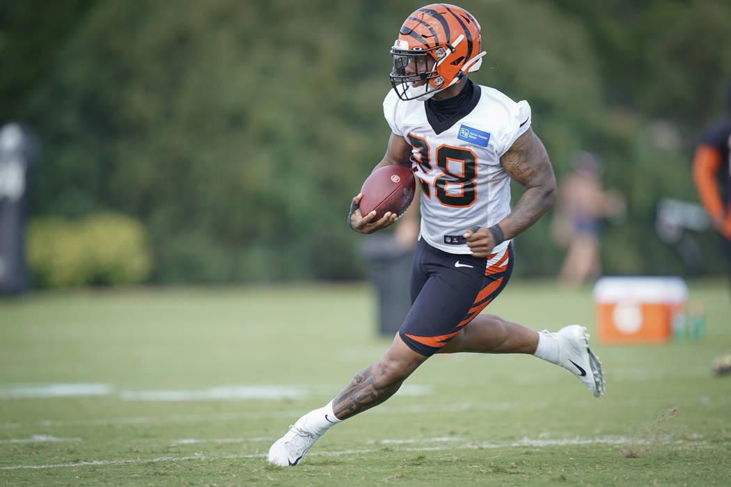Cincinnati Bengals running back Joe Mixon (28) runs during a play during NFL football training ...
