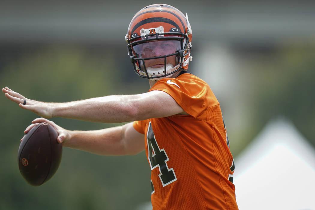 Cincinnati Bengals quarterback Andy Dalton (14) throws the ball during NFL football training ca ...