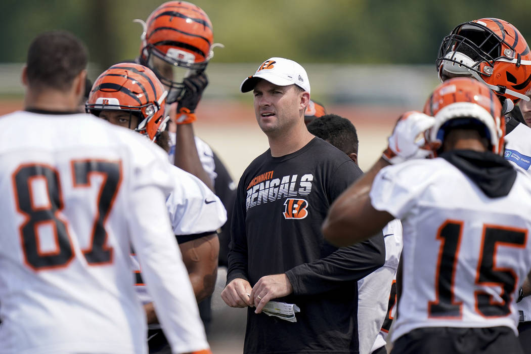 Cincinnati Bengals head coach Zac Taylor talks his players during the first day of NFL football ...