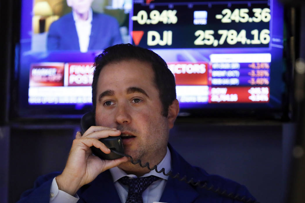 Specialist Gennaro Saporito works on the floor of the New York Stock Exchange, Wednesday, Aug. ...