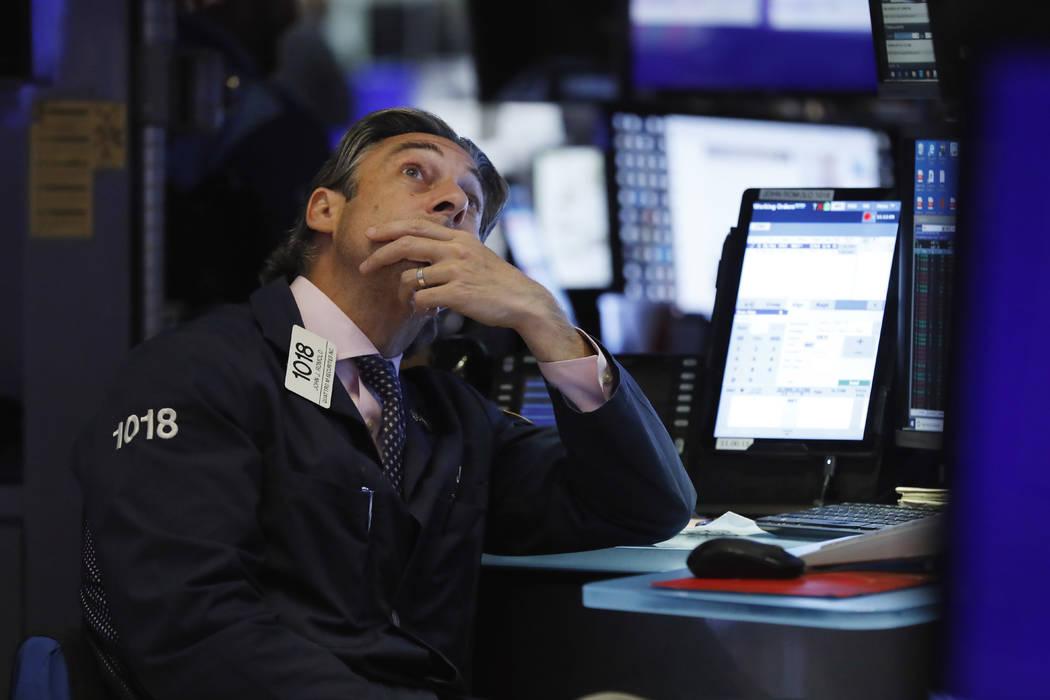 Trader John Romolo works on the floor of the New York Stock Exchange, Wednesday, Aug. 7, 2019. ...