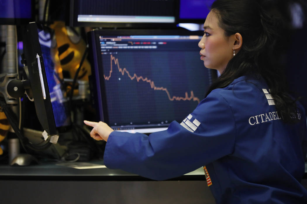 Specialist Lingbo Jiang works on the floor of the New York Stock Exchange, Wednesday, Aug. 7, 2 ...