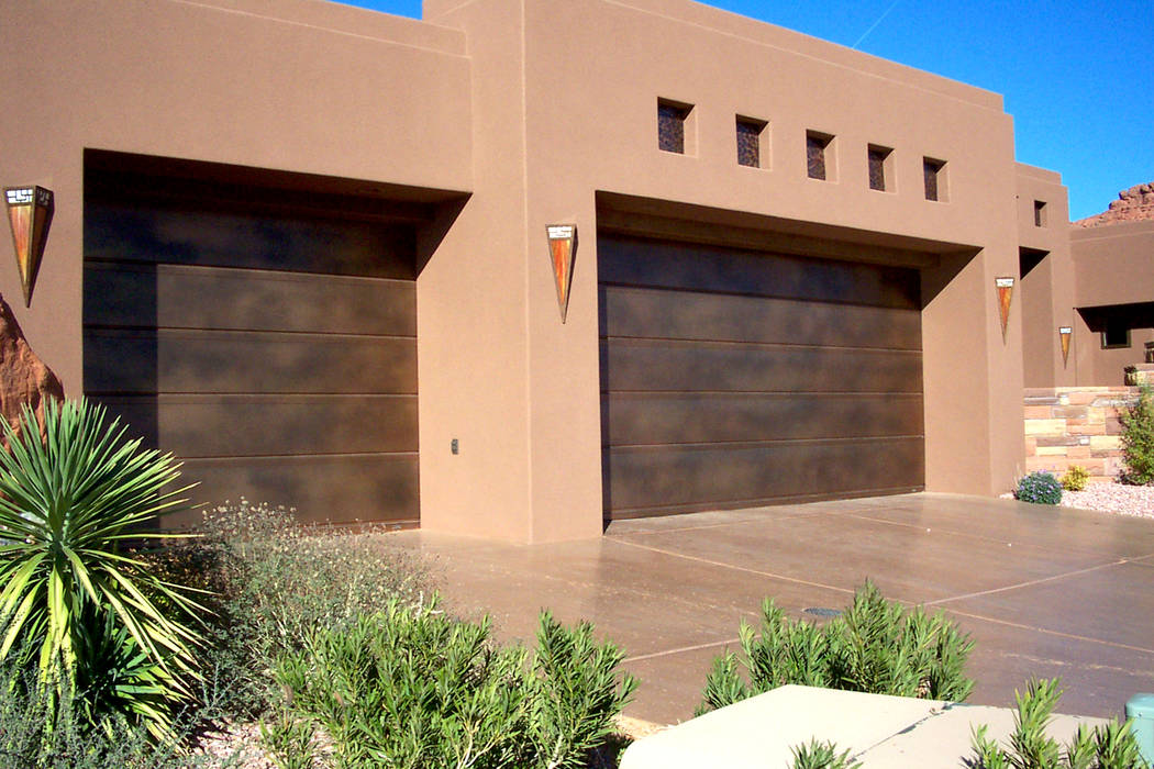 Martin Garage Door This stylish and modern home is fronted by a real copper flush-panel garage ...