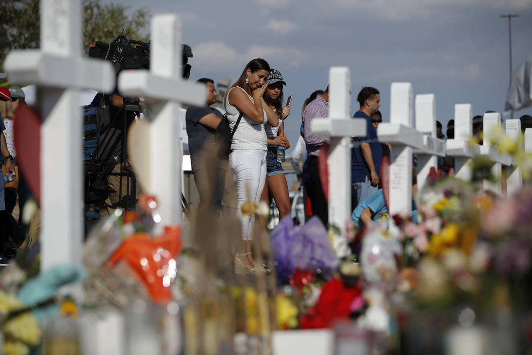 People visit a makeshift memorial, Monday, Aug. 5, 2019, at the site of a mass shooting at a sh ...