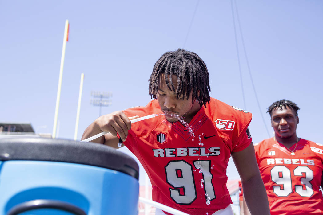 UNLV's defensive lineman Nate Neal (91) drinks water during the team's photo day at Sam Boyd St ...