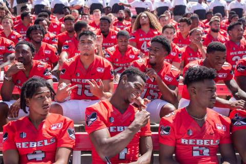 UNLV football players get into place during the team's photo day at Sam Boyd Stadium in Las Veg ...