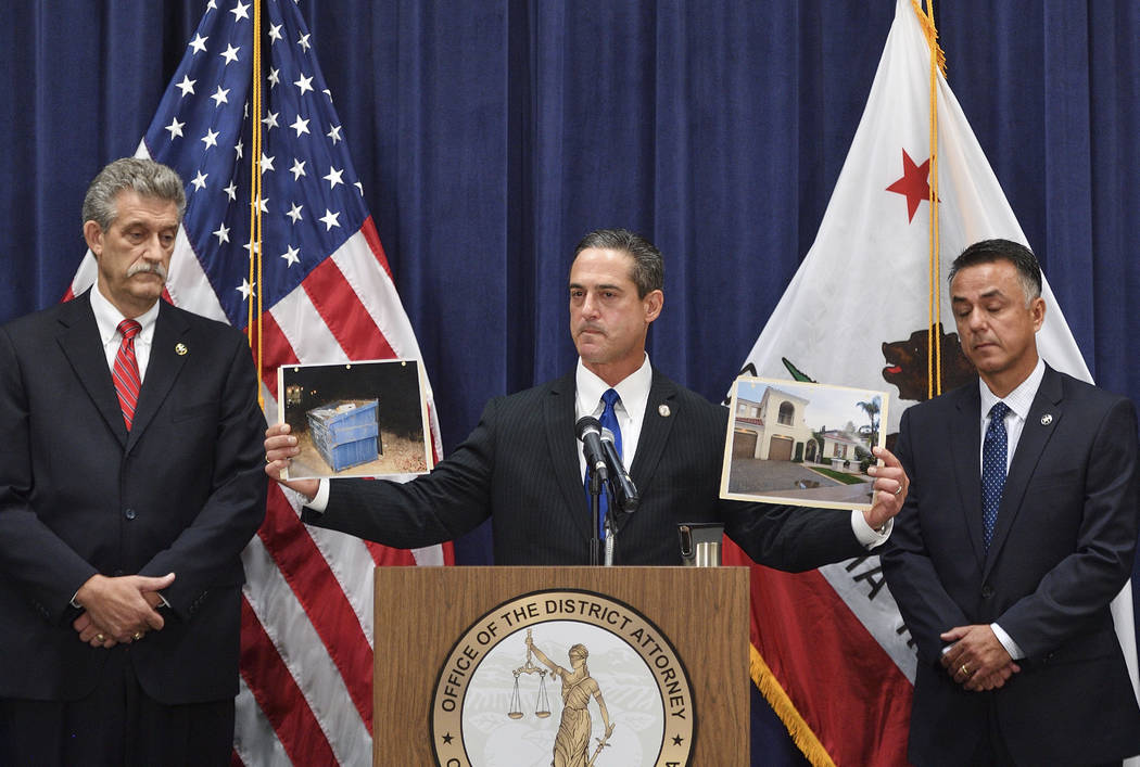 Orange County District Attorney Todd Spitzer holds up pictures of the home of Peter Chadwick an ...