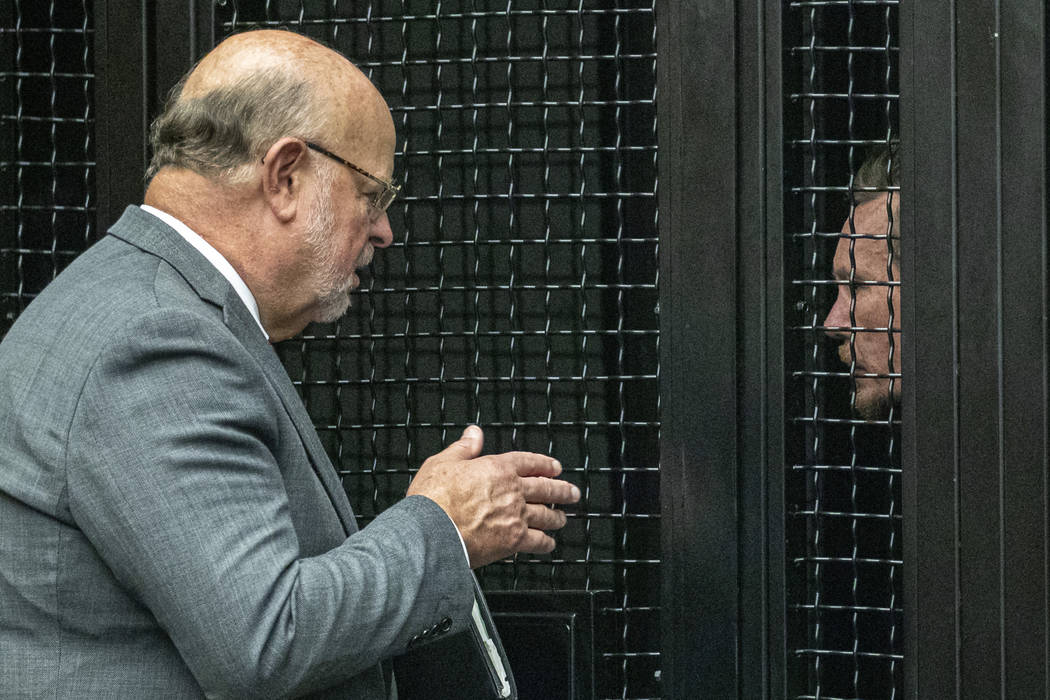 Defense attorney Robert Sanger, left, talks to Peter Chadwick, who is charged with killing his ...