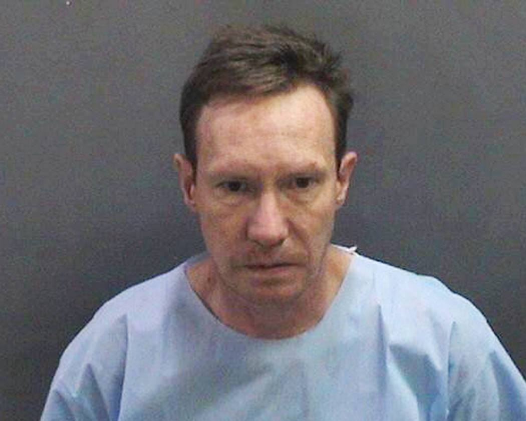 This undated booking photo provided by the Newport Beach, Calif., Police Department shows Peter ...