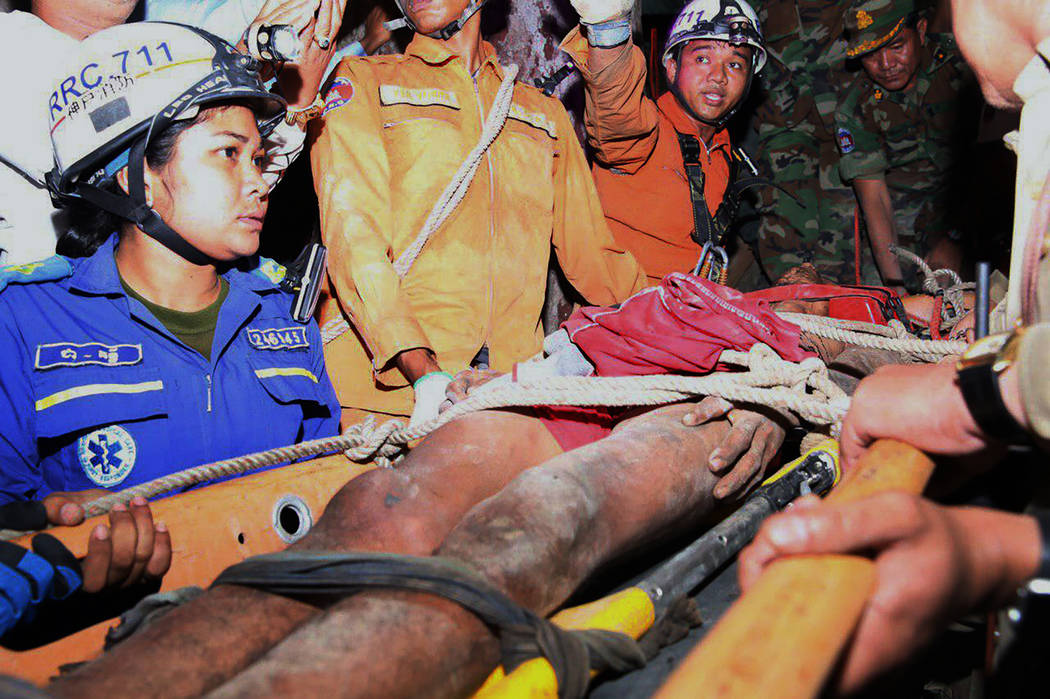 In this photo provided by the Battambang Province Authority Police, rescuers carry Sum Bora, a ...